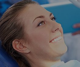 Smiling woman relaxed in dental chair